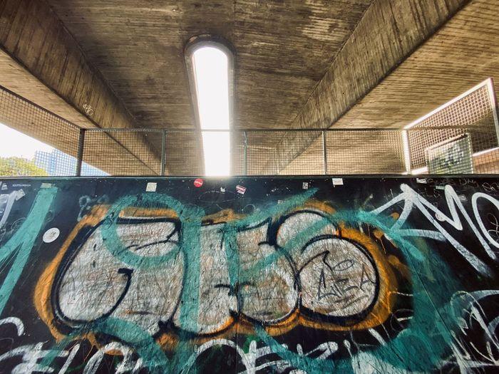 Low angle view of illuminated graffiti on wall