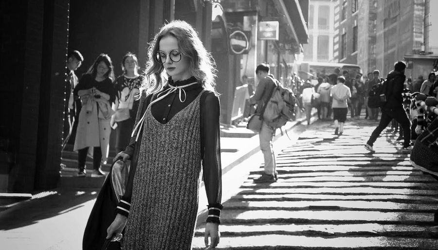 Street Photography Beautiful Woman Young Lady Young Women Black & White Blackandwhite Street Photography Street Streetphotography Model Real People City Lifestyles Architecture Street Women Day Sunlight Walking People Incidental People Adult Young Adult Leisure Activity Young Women
