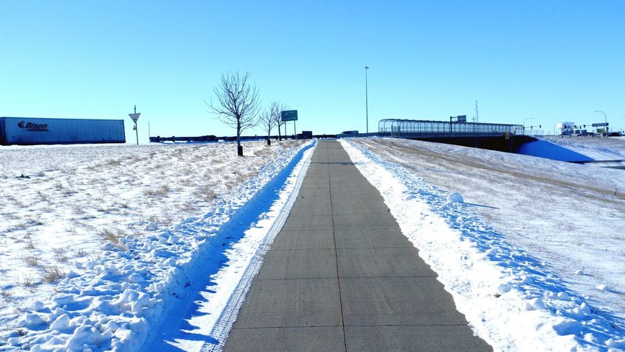 QVHoughPhoto FujiFilmX100 Fargo Northdakota MidWest Winter Snow Sidewalk Semi Bison Life2