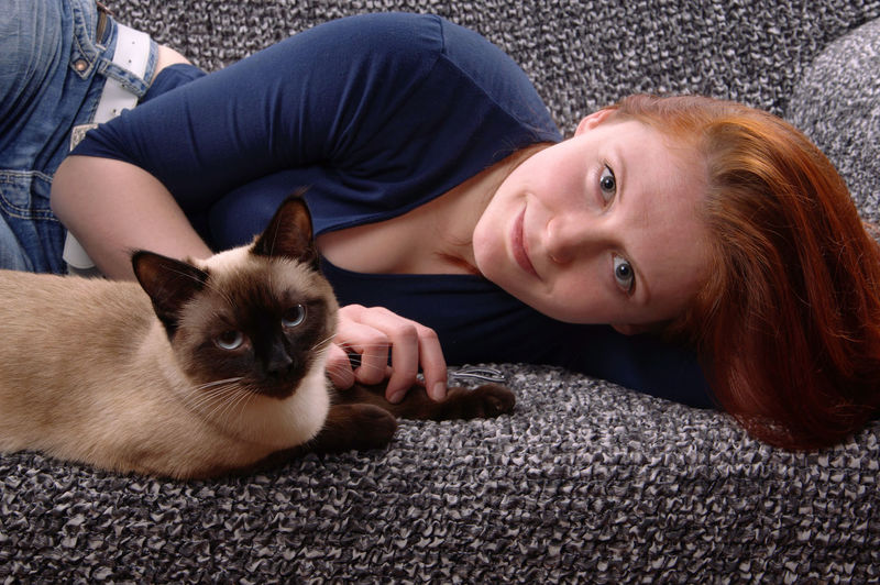 Woman with cat looking at camera