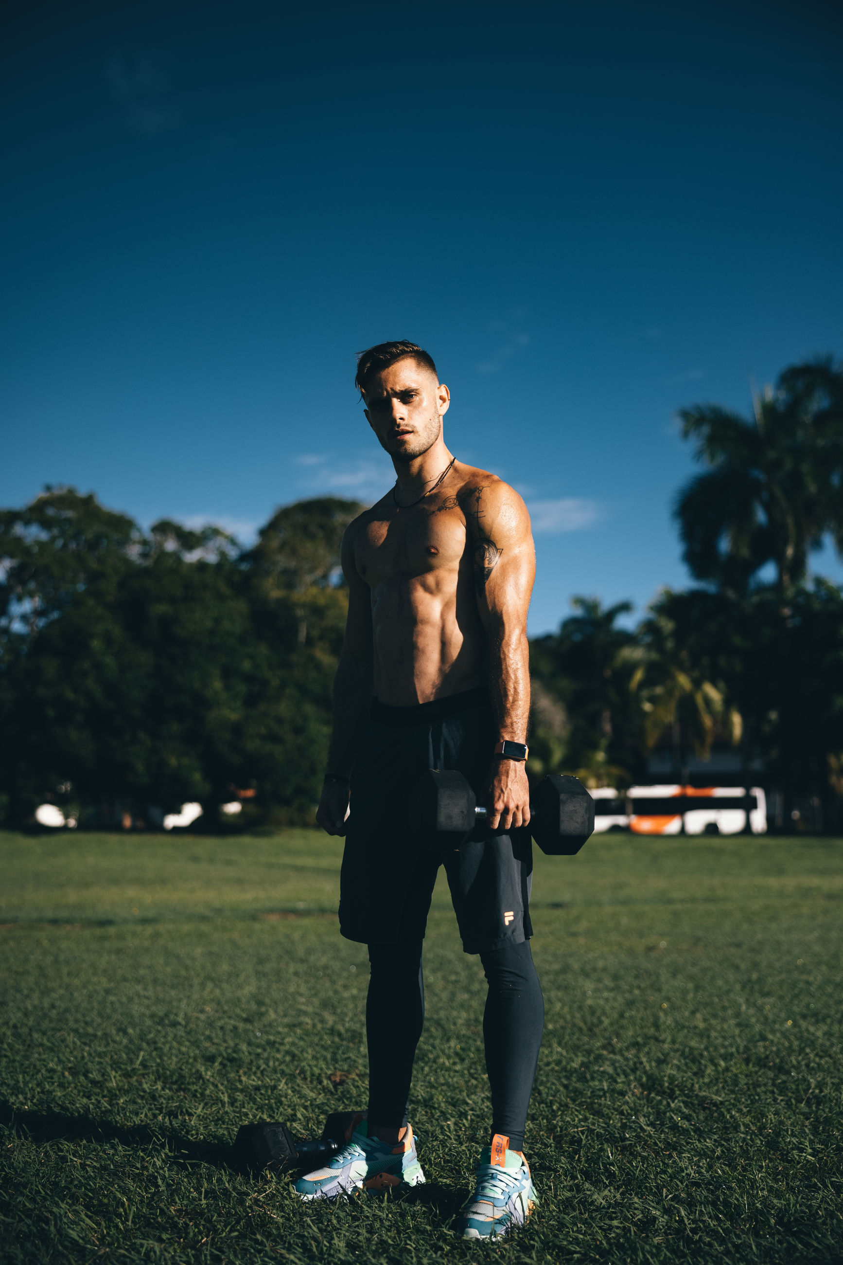 adult, sports, one person, full length, young adult, sky, grass, nature, lifestyles, standing, men, plant, blue, athlete, clothing, muscular build, exercising, portrait, leisure activity, front view, activity, outdoors, fashion, sports clothing, sports training, casual clothing, copy space, looking, person, player, car