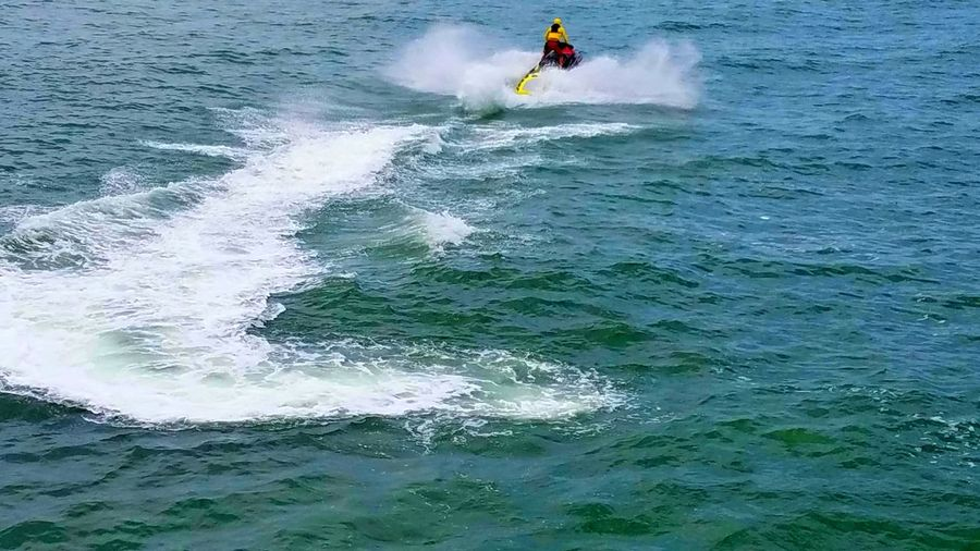 Skijet Ski Jet Sport One Person Extreme Sports Adventure Motion Water Speed Leisure Activity Aquatic Sport Outdoors Adult RISK Dramatic Light Ocean Waves Wake Interesting Perspectives Summer Strong Copyspace Enjoyment Lifestyles Vacations Breathing Space