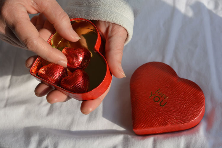 Enjoying the chocolates from the love you heart box on valentine's day
