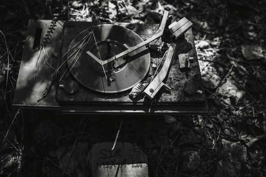 The music plays on... Natural Light In The Forest Still Life Black And White Old Broken Record Player Junk No People Day Music Outdoors