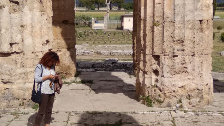 EyeEm Selects Real People One Person Lifestyles Day Shadow Outdoors Standing Full Length Women Architecture Built Structure Adult Woman Texting Young Women Young Adult City Adults Only Heritage Heritage Building Paestum Italia Tourism Tourist Culture Paint The Town Yellow Been There. Done That. Lost In The Landscape The Week On EyeEm EyeEmNewHere Connected By Travel Be. Ready.