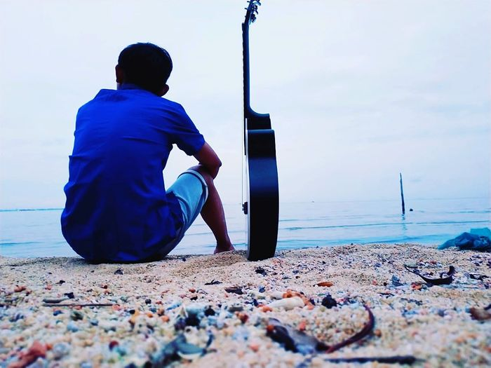 beac and music Water Manual Worker Working Sea Beach Full Length Men Occupation Sand Blue First Eyeem Photo