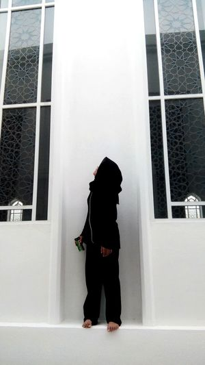 Girl looking up while standing at mosque