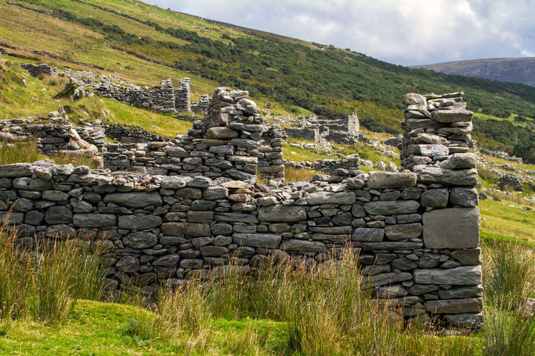 Abandoned Stone House On Field
