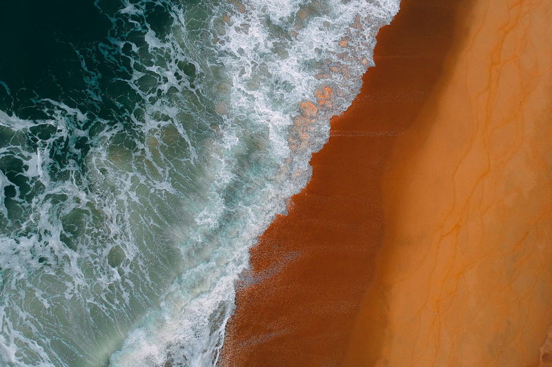 aerial view of sea waves water texture background Sea Motion Water Wave No People Aquatic Sport Sport Rock Beauty In Nature Beach Solid Nature Rock - Object Day Land Power In Nature Outdoors Rock Formation