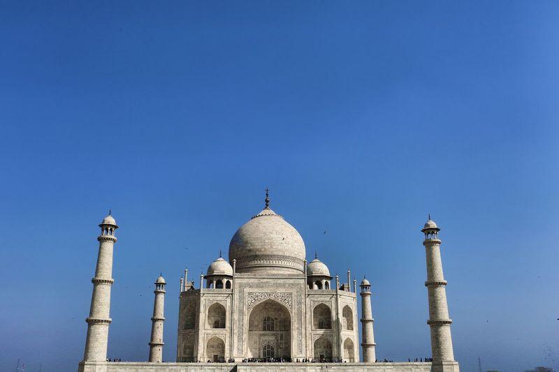 Low angle view of taj mahal against blue sky