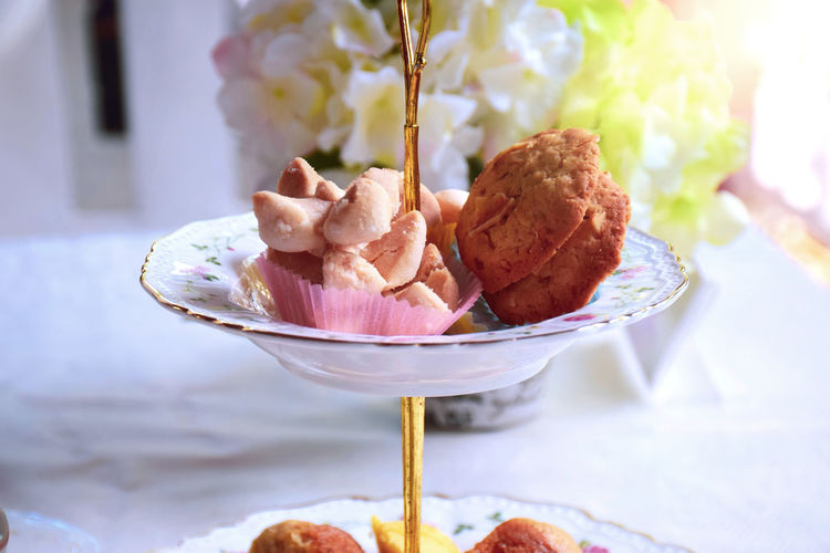 Tea time. Cake Cookie Tier Tea Time. Afternoon Tea Bowl Close-up Dessert Focus On Foreground Food Food And Drink Freshness Indoors  No People Plate Ready-to-eat Snack Still Life Sweet Sweet Food Table Serving Size Served Temptation Pastry Starter