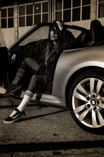 Woman in high angle view of car