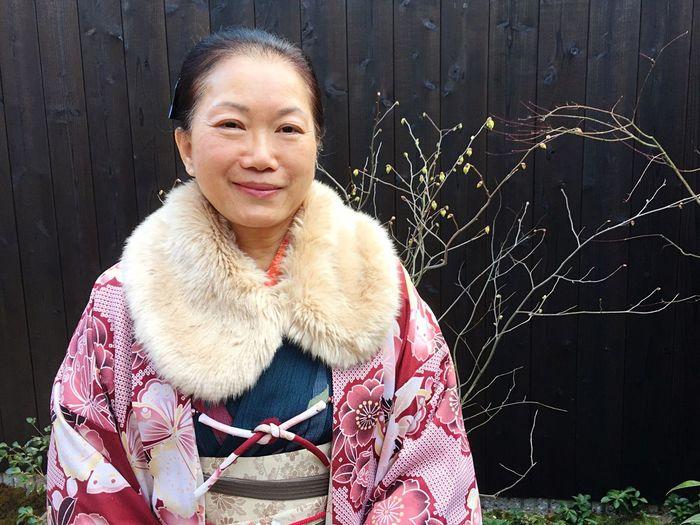 Portrait of smiling woman standing at kiyomizu-dera