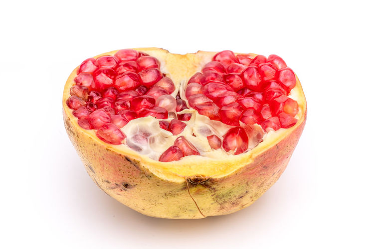 Attractive fruit in color, pomegranates Drought Resistant Food Fruit Heart Insect Repellent Mature Adult Medicinal Micronutrients Nutrition Pomegranate Pomegranate Seeds Red Red Heart Rich Supplement Sweet Food Temperate Zone Tropical Vitamins Water White Background Studio Shot Food And Drink Healthy Eating Wellbeing Cut Out Close-up Indoors  Still Life Freshness Single Object No People SLICE Love Heart Shape Cross Section Ripe Chopped Temptation