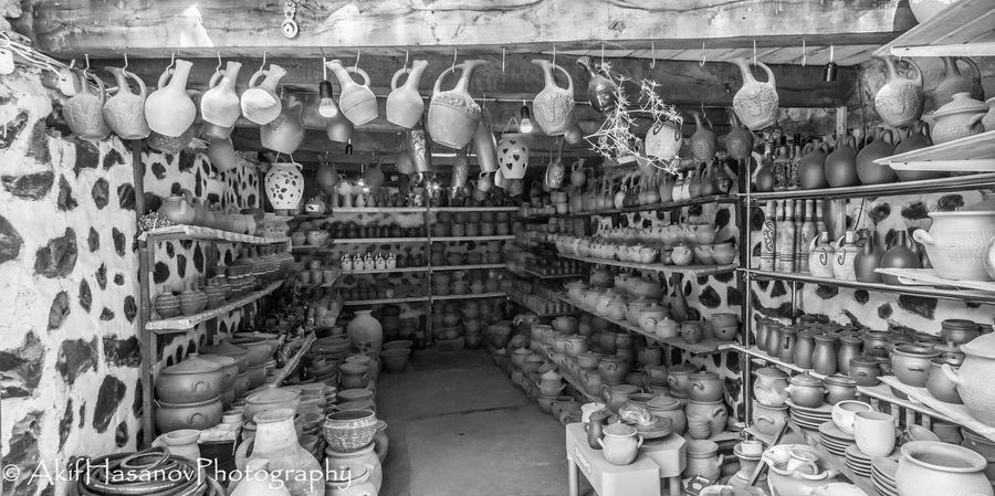 Clay Dishes Clay Jugs For Sale In A Row Large Group Of Objects No People Retail  Shelf Historical Building