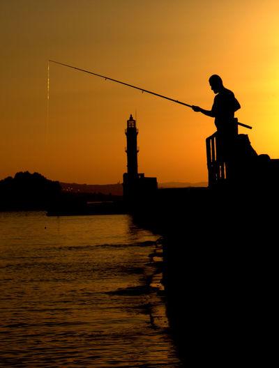 Fishing in the sunset - chania - crete - greece