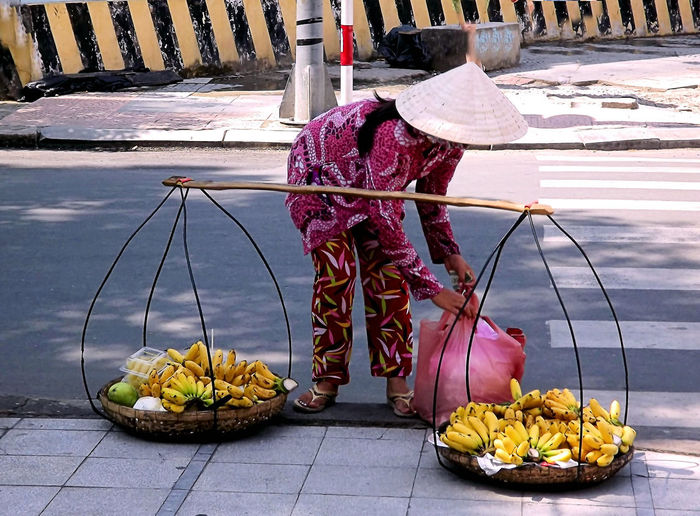 Person with vegetables on street