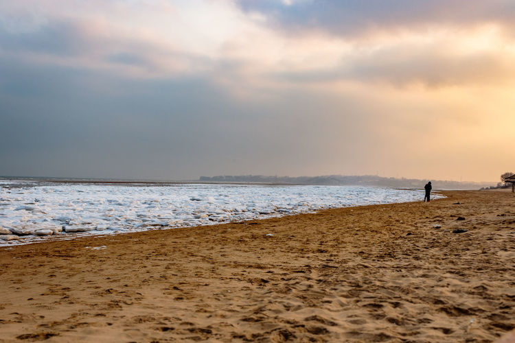 Frozen Hebei Ice Seashore Winter Beach Beauty In Nature Beidaihe China Day Horizon Over Water Lifestyles Nature Outdoors Qinhuangdao Real People Sand Sea Seascape Seaside Sky Snow Sunset Tranquility Water