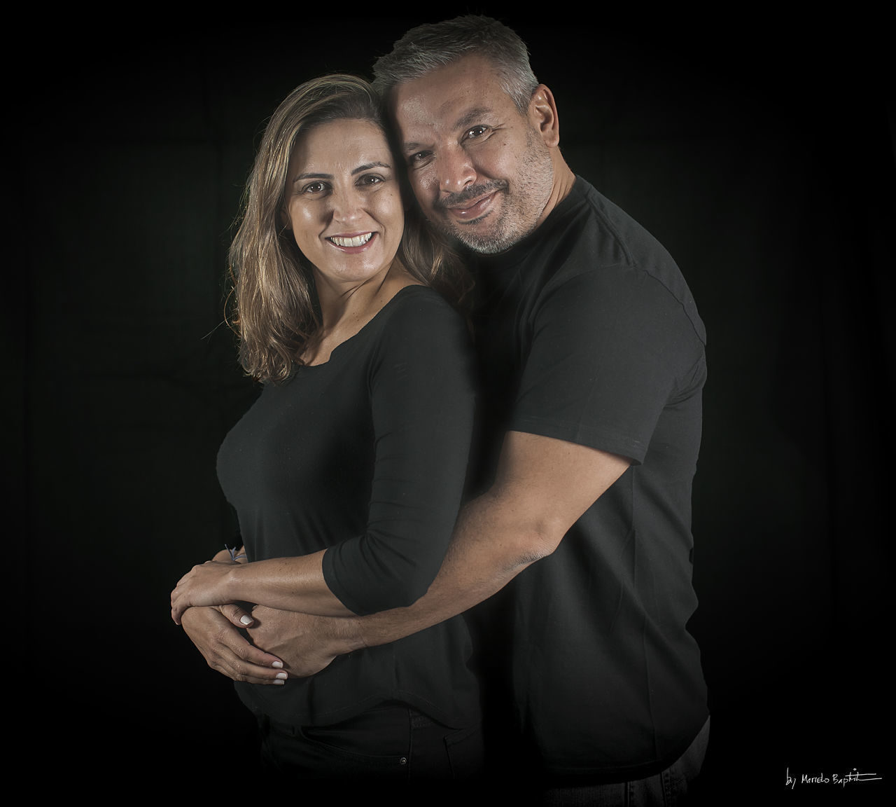 two people, black background, smiling, love, looking at camera, portrait, real people, pregnant, togetherness, lifestyles, embracing, happiness, studio shot, standing, young women, young adult, bonding, leisure activity, night, indoors, abdomen