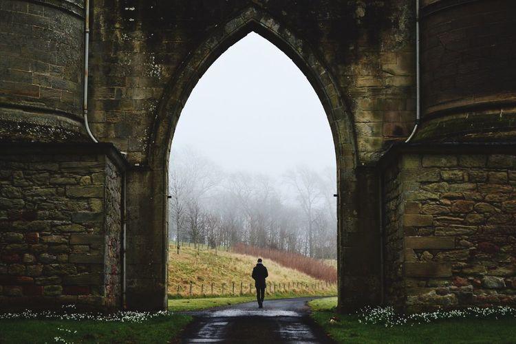 Woman walking in old ruin