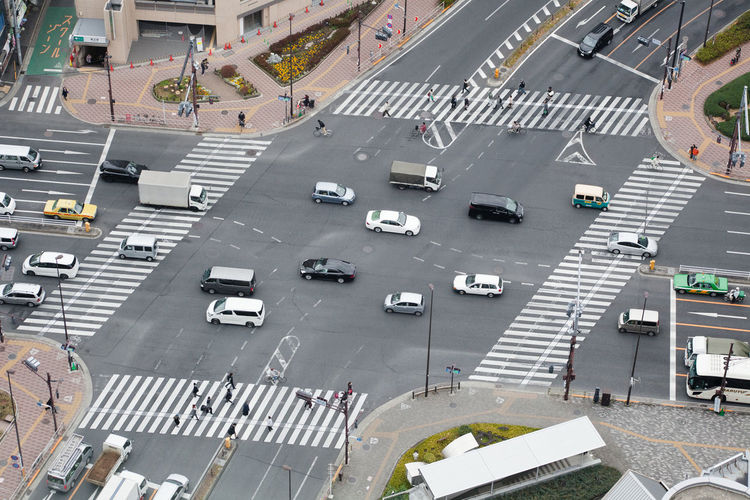 Aerial View Car City City Street Elevated View High Angle View Human Settlement Intersection Japan Land Vehicle Mode Of Transport On The Move Residential District Road Road Marking Street Tokyo Top Perspective Traffic Transportation Vehicle Pmg_tok