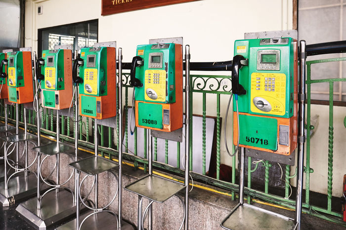 BANGKOK, THAILAND - July 6, 2018: Public telephone booth at the main central railway station Bangkok Thailand. Button LINE Long Distance  Public Telephone Services Booth Call City Coin Communication Connection Dial Handset Landline Phone No People Number Outdoors Payphone Phone Public Service Talk Technology Telecommunications Equipment Urban