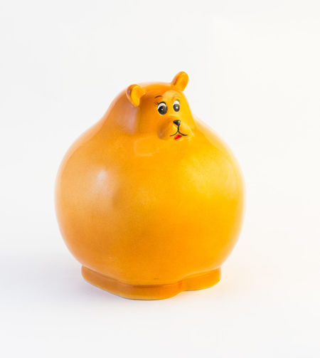 Children's money box for the money made in the form of a yellow bear. Bear Box Children Close-up Coins Concepts Container Currencies Design Finances Form Ideas Isolated Made Money No People Protection Security Shape Single Studio Shot Symbol Wealth White Background Yellow
