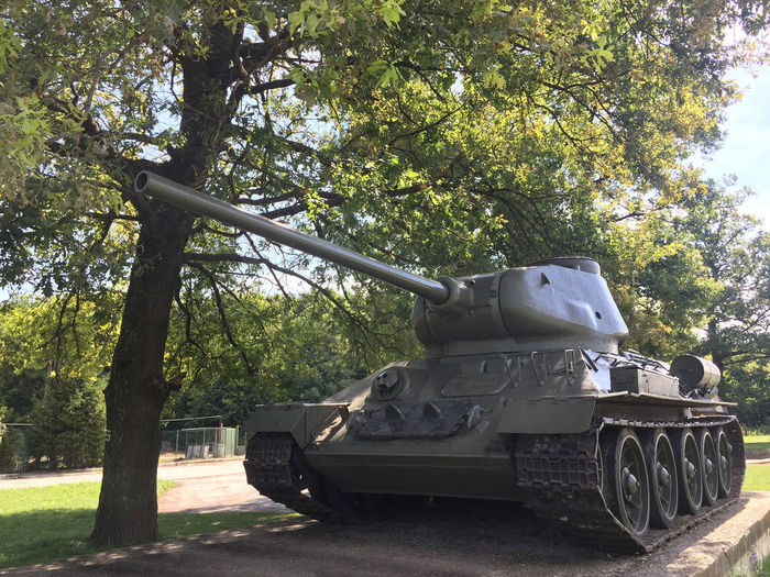 Russian t 34 tank under tree Arm Arrack Canon Caterpillar Day Military Monument Old Outdoors Robust Russian T34 Tank Tree Turret Warmachine WWII