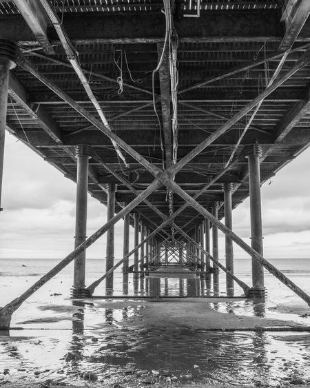Interior of bridge over sea against sky