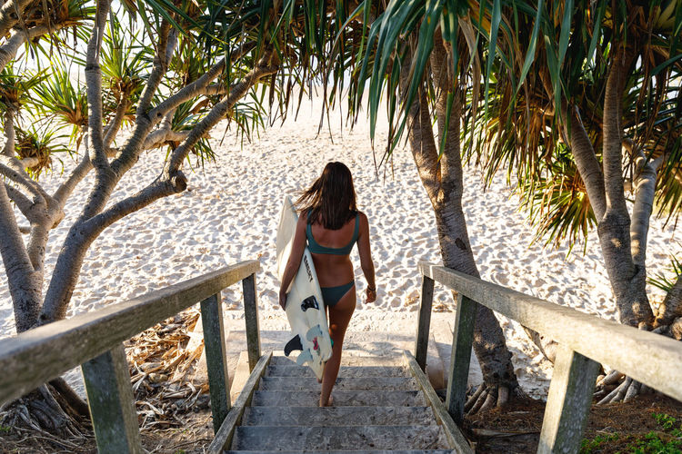 Byron Bay, Australia Full Length One Person Day Rear View Casual Clothing Leisure Activity Adult Young Adult Women Real People Railing Lifestyles Young Women Clothing Fashion Outdoors Hairstyle Surf Surfing Australia Byron Bay Travel Destinations Travel Summer Surfer