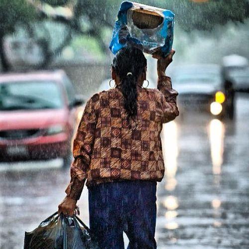 """Waiting"" Laredo LaredoTx Downtown Women rain weather"