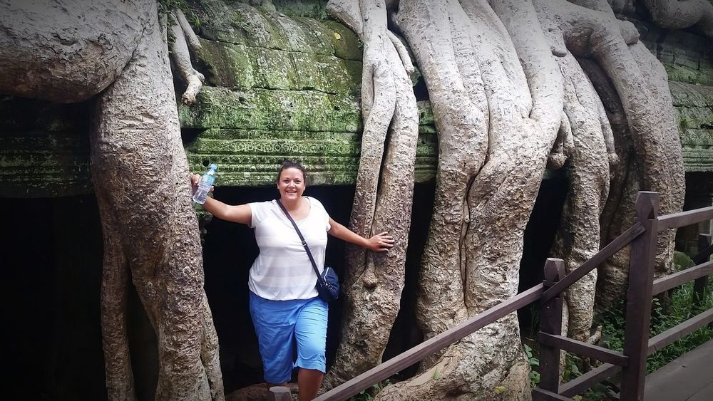 Trees & Ancient Buildings Travel Photography Tranquility Travel Cambodia Tomb Raider  Adult Female Tree Full Length Standing Front View Casual Clothing Tree Trunk Branch Plant Bark Bare Tree Lone Treelined