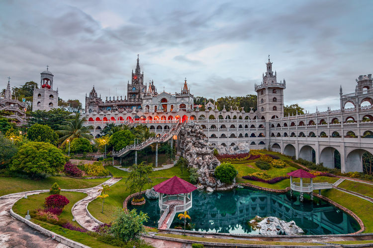 Simala Parish Church - Cebu's Church Castle Travel Destinations Cityscape Outdoors Architecture City River Sky Cloud - Sky Bridge - Man Made Structure Urban Skyline No People Building Exterior EyeEm Best Shots Check This Out Church Church Architecture Day Politics And Government Water