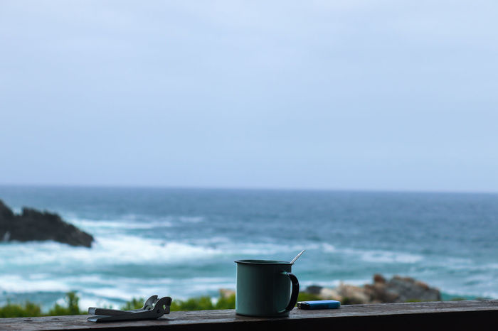 Coffee before a long hike with the ocean as a backdrop Background Blur Relaxing Awake Escape Calm Coffee Hiking Adventure Explore Camping #EyeEmBestShots EyeEm Selects Morning Sea Horizon Over Water Water Tranquility Tranquil Scene Beach Scenics Nature No People Outdoors Beauty In Nature