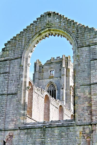 Tower through archway Abbey Abbey Brickwork Abbey Ruins Abbey Ruins Arch Architecture Architecture Building Exterior Built Structure Church Façade Fountain's Abbey Fountains Abbey Henry VIII Henry VIII Henry VIII Reformation Historic History Place Of Worship Religion Religions Religious Architecture Religious Place Spirituality The Reformation