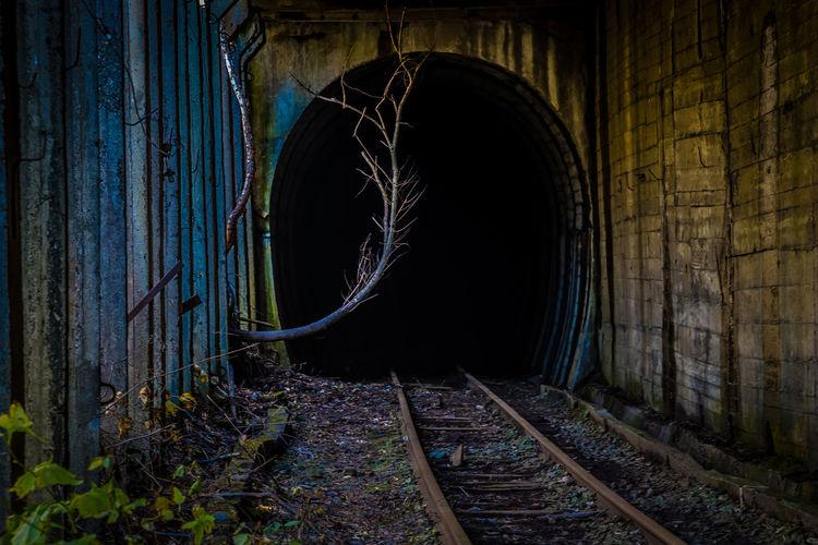 Abandoned Railroad Tracks Leading Towards Tunnel