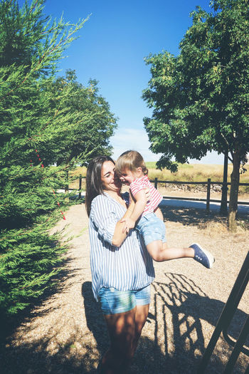 Child Two People Childhood Family Togetherness Women Tree Emotion Bonding Plant Casual Clothing Females Love Real People Leisure Activity Nature Lifestyles Parent Positive Emotion Sunlight Daughter Son Outdoors Family Mother