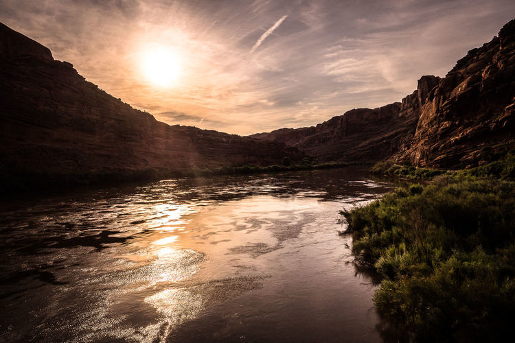 Beauty In Nature Cloud Cloud - Sky Colorado River Idyllic Lens Flare Mountain Mountain Range Nature No People Non Urban Scene Non-urban Scene Outdoors Reflection Remote Rippled Scenics Sky Sun Sunbeam Sunlight Sunset Tranquil Scene Tranquility Water