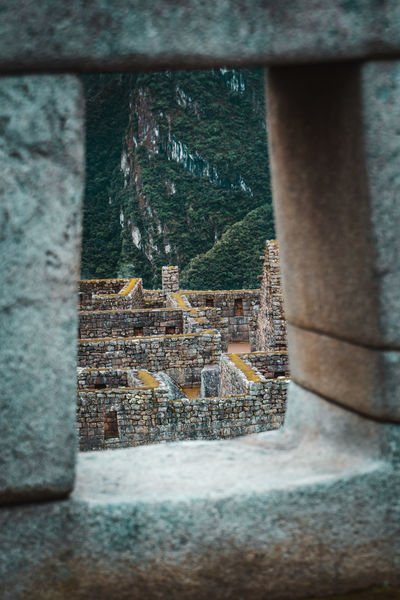 The moment you enter Machu Picchu Discover Your City Morning Aguas Calientes Ancient Ancient Civilization Architectural Column Architecture Building Building Exterior Built Structure Clouds Day Explore Focus On Background History Moody Nature No People Old Outdoors Selective Focus Stone Wall The Past Travel Destinations Window