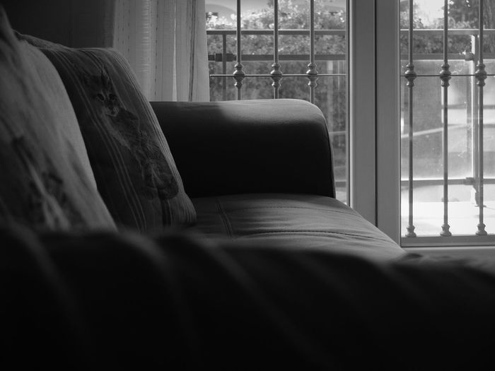 Close-up of sofa on bed at home