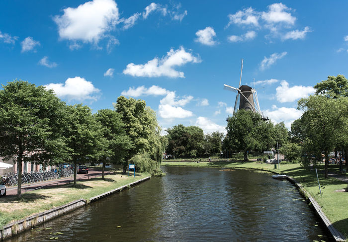 Alternative Energy Architecture Day Grass Holland Leiden Nature No People Outdoors Renewable Energy River Sky Traditional Windmill Tree Water Wind Power Wind Turbine Windmill Your Ticket To Europe