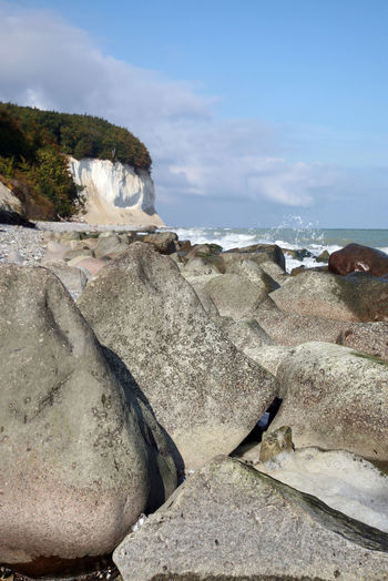 Jasmund national park on the island Ruegen in Germany with it's chalk cliffs and the Baltic Sea Baltic Sea Beach Chalk Cliff German Horizon Over Water Island Jasmund National Park Nature No People Outdoors Rügen Sand Scenics Sea Sky Stone Tranquil Scene