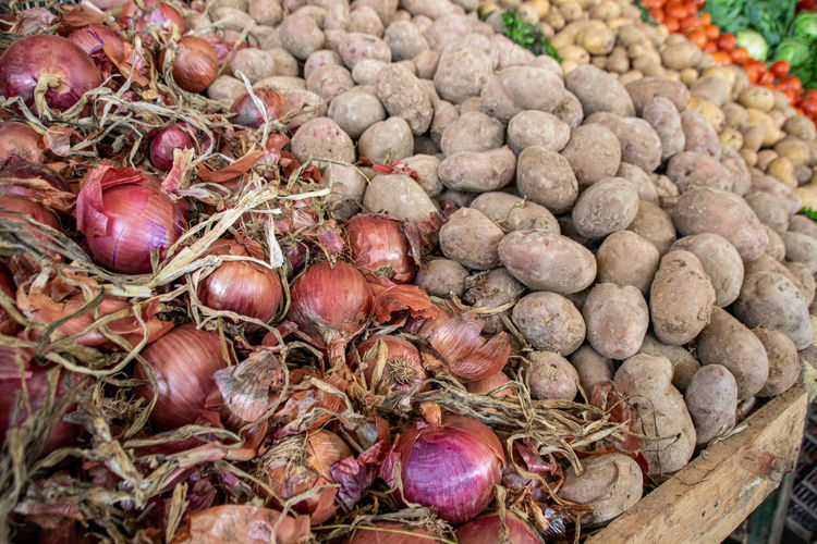 Potatoes and red onions for sale at a souk in Morocco Africa African Agadir Ancient Arabian Bazaar Business Casablanca Casbah Cooking Culture Essaouira Ethnic Fez Food Fort Fruit Handmade History Landmark Market Marrakech Marrakesh Medina Moroccan Morocco Muslim North Ocean Onion Onions Oriental People Potato Potatoes Rabat Red Onion Sale Shop Souk Store Street Tourism Touristic Town Traditional Travel Vacation Veg Vegetables