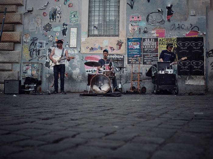 Street band Lifestyles Rock Band Music Built Structure Architecture Real People Building Exterior City Graffiti Street Day