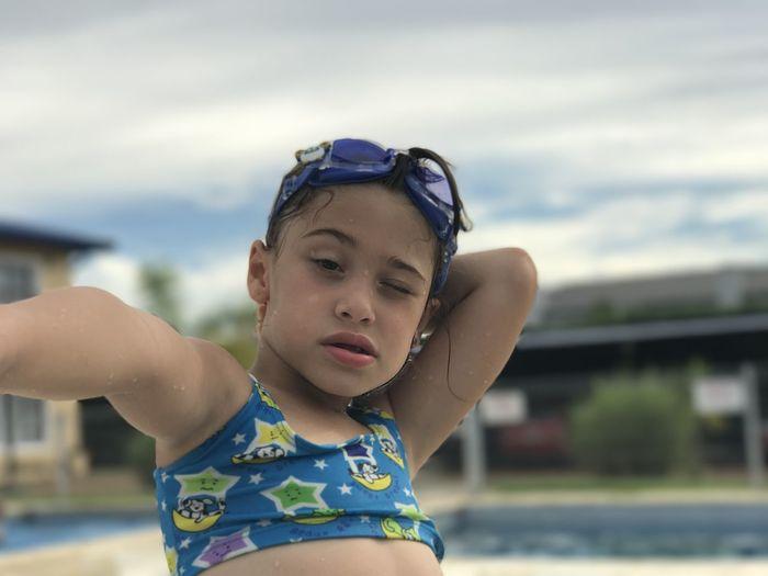 Cute girl wearing swimwear on poolside