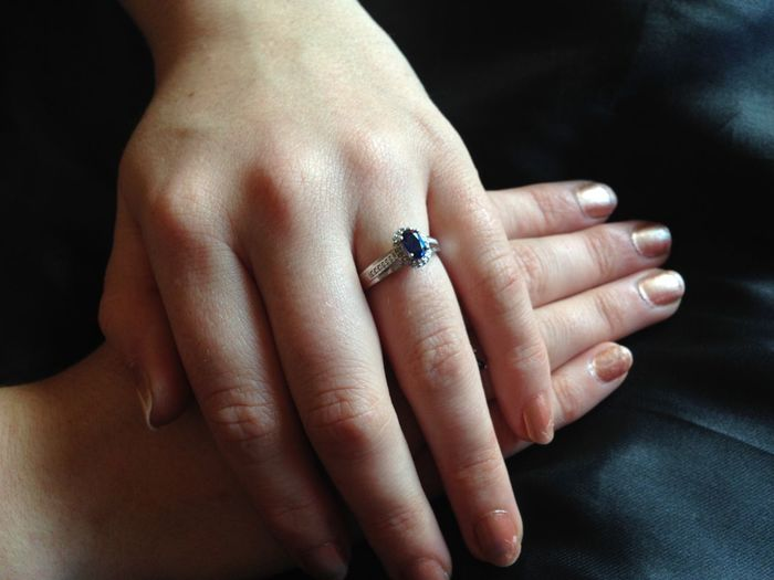 Midsection of woman wearing diamond ring