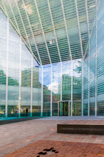 Architecture Building Building Exterior Built Structure City City Life Day Glass - Material Incidental People Low Angle View Modern No People Office Building Outdoors Pattern Railing Reflection Skyscraper Sunlight Window