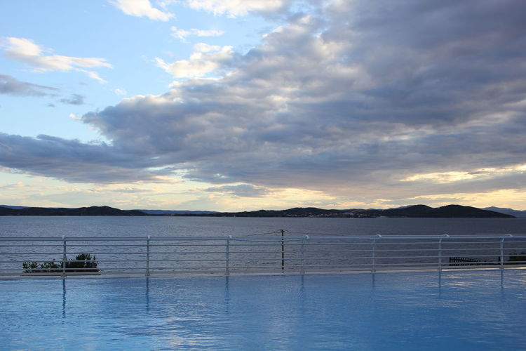 Overlapping the pool and the sea with the sky Beauty In Nature Cloud - Sky Day Grece ❤ Greece Morning Light Morning Sun Nature Outdoors Overlapping The Pool And The Sea With The Sky Sea Sky Water