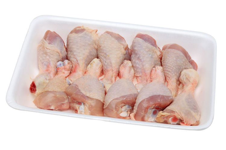 Image of a polystyrene tray with raw chicken drumsticks isolated against a white background. Chicken Chicken Skin Chicken Meat Close-up Container Food Food And Drink Freshness Meat Proteinsnack Raw Drumsticks Raw Food White Background