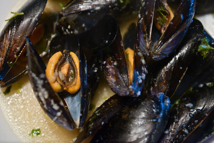 High Angle View Of Mussels In Plate On Table